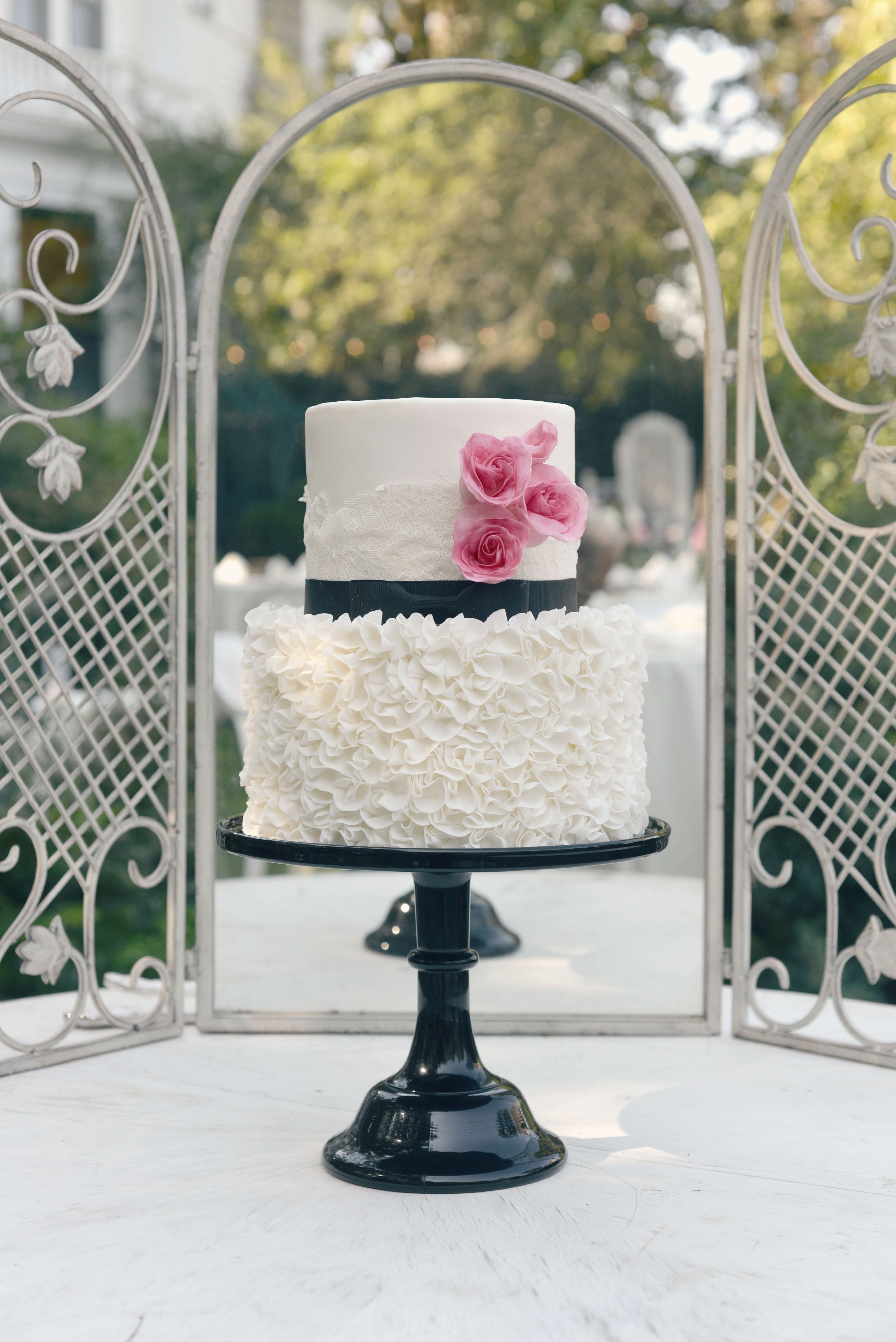 Formal white wedding cake with black ribbon and fushia sugar formal white wedding cake with black ribbon and fushia sugar flowers and white sugar lace dhlflorist Image collections