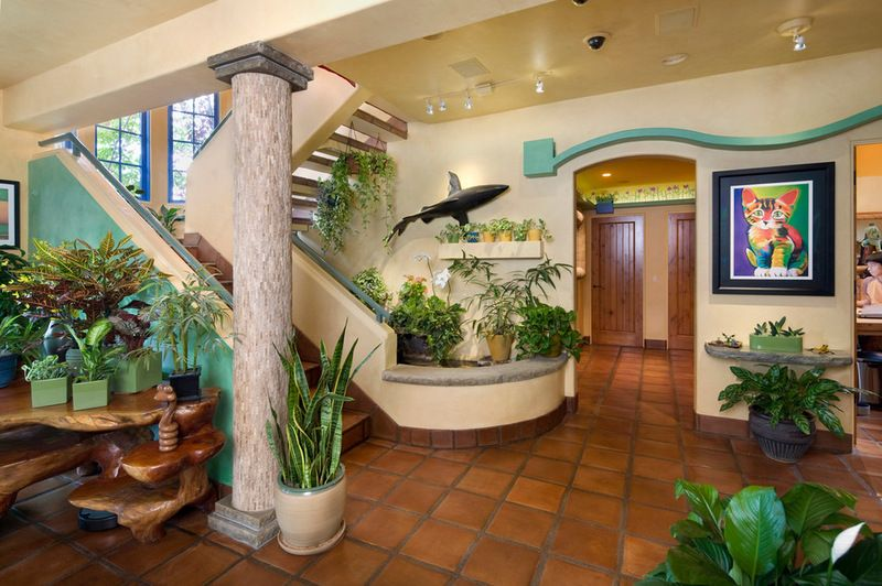 An S Shaped Walkway Hangs On The Wall Near A Koi Pond Which The