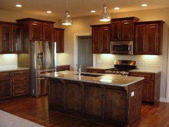 347762402447351524 Dark Cabinets And Floors; Santa Cecilia Light Granite  And Light Colored Backsplash.