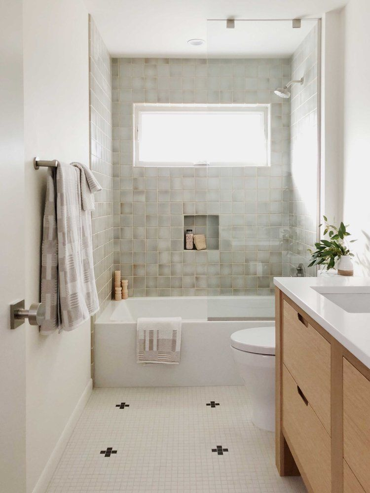 Minimal Master Bath With White Floor Tiles And Gray Green Tile At The Shower And Tub The Cabinet Is Bathroom Interior Design Bathroom Interior Small Bathroom
