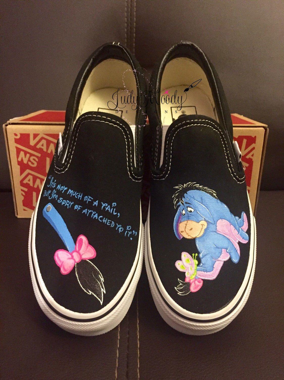 This pair of custom, hand painted black Vans Slip on shoes