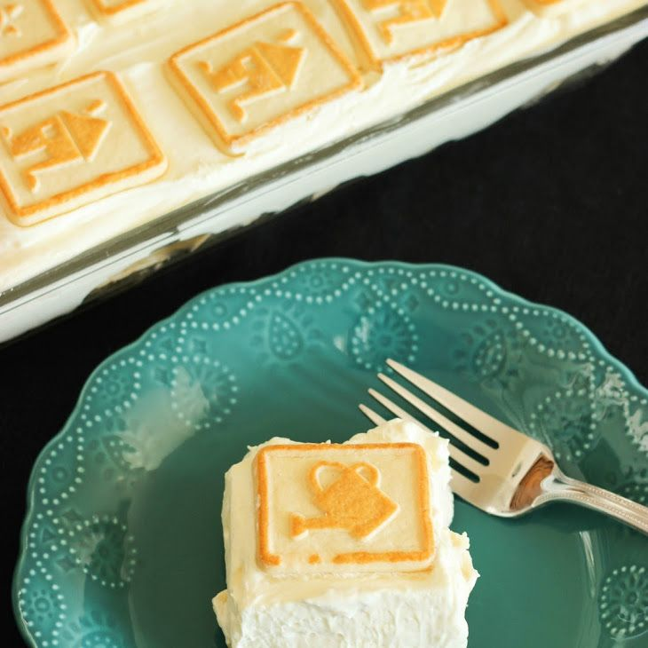 Four Layer Banana Puding Recipe Desserts with cookies, bananas, milk, vanilla instant pudding, cream cheese, sweetened condensed milk, whipped topping