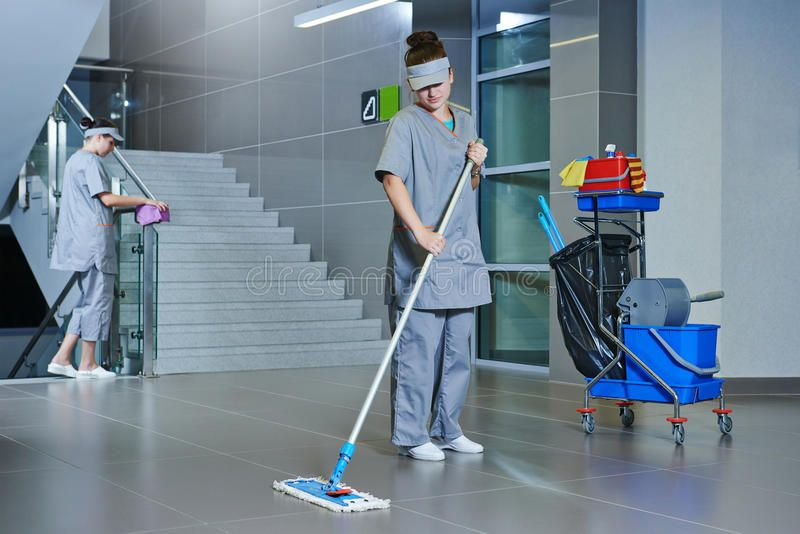 Worker Cleaning Floor With Machine Floor Care And Cleaning