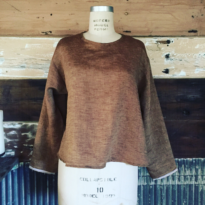 Handmade linen shirt with long sleeves.