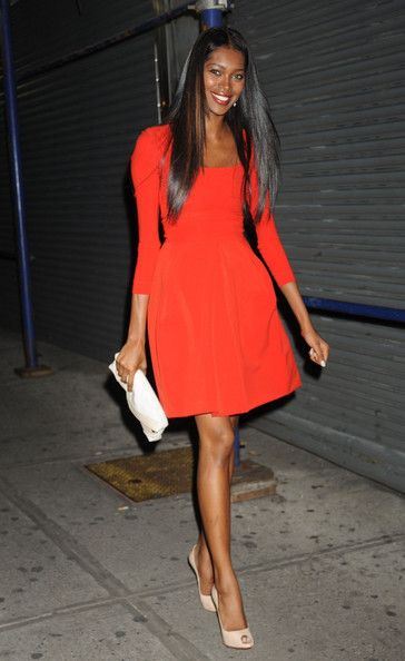 Jessica White in a lovely little red cocktail dress