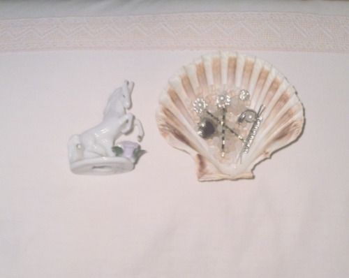 oiseau-jardin: a porcelain horse that belonged to my aunt, cca. 1950s and a seashell filled with pearls and hair clips