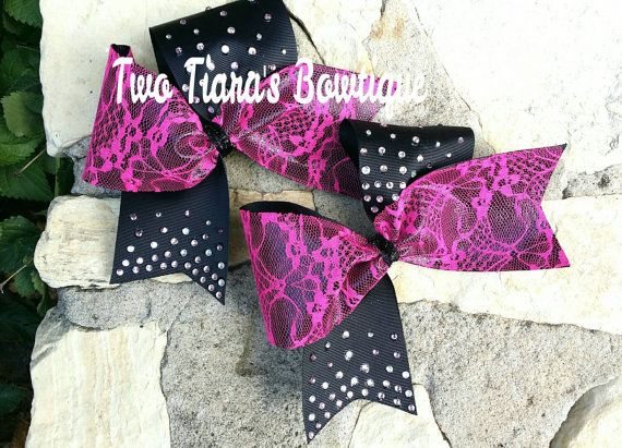 Gorgeous black and pink lace cheer bow with diamonds by Two Tiara's Bowtique on Etsy or Facebook as TwoTiaras Bowtique!  Teams, squads, state, competition, softball, pro shops!  Great for pink out and breast cancer awareness cheer bows!  Check out this item in my Etsy shop https://www.etsy.com/listing/216864502/black-pink-lace-diamond-cheer-bow-team