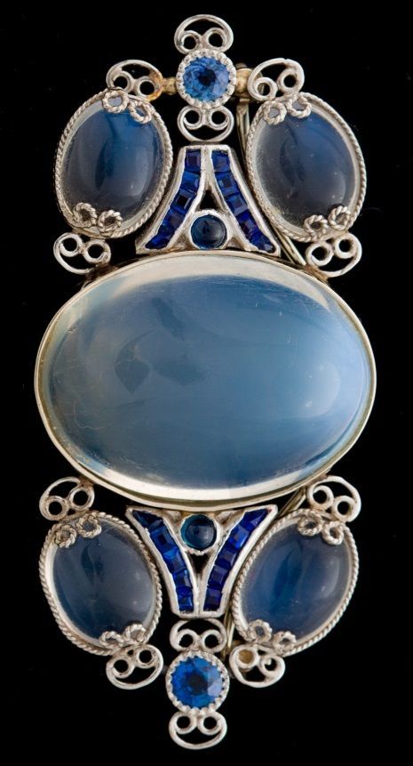 e82920da4 An Exquisite Moonstone & Sapphire Brooch attributed to Louis Comfort Tiffany.  Composed of Moonstones and Sapphires within a scrolled platinum setting.