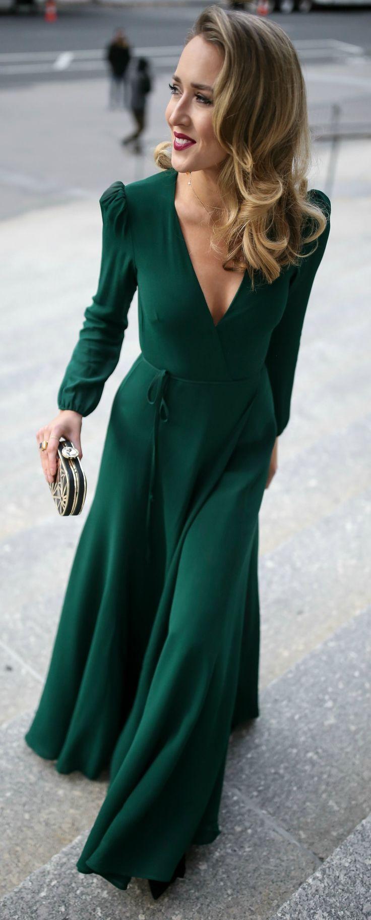 Emerald green long-sleeve floor-length wrap dress, black and gold geometric  pattern evening clutch, multicolor beaded statement earrings, black vel…
