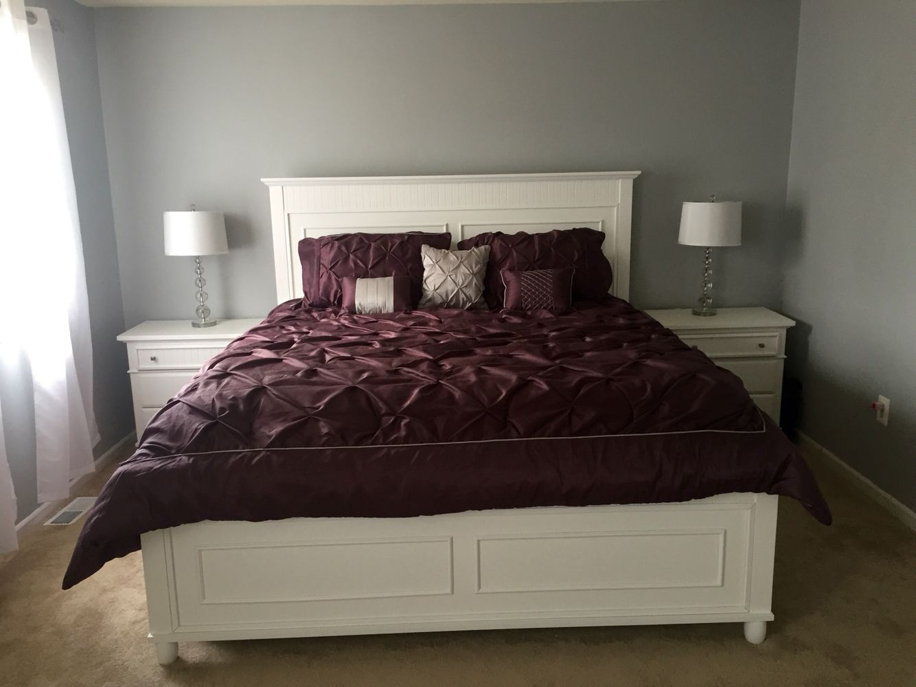 Master bedroom. Light grey walls with a plum comforter ...
