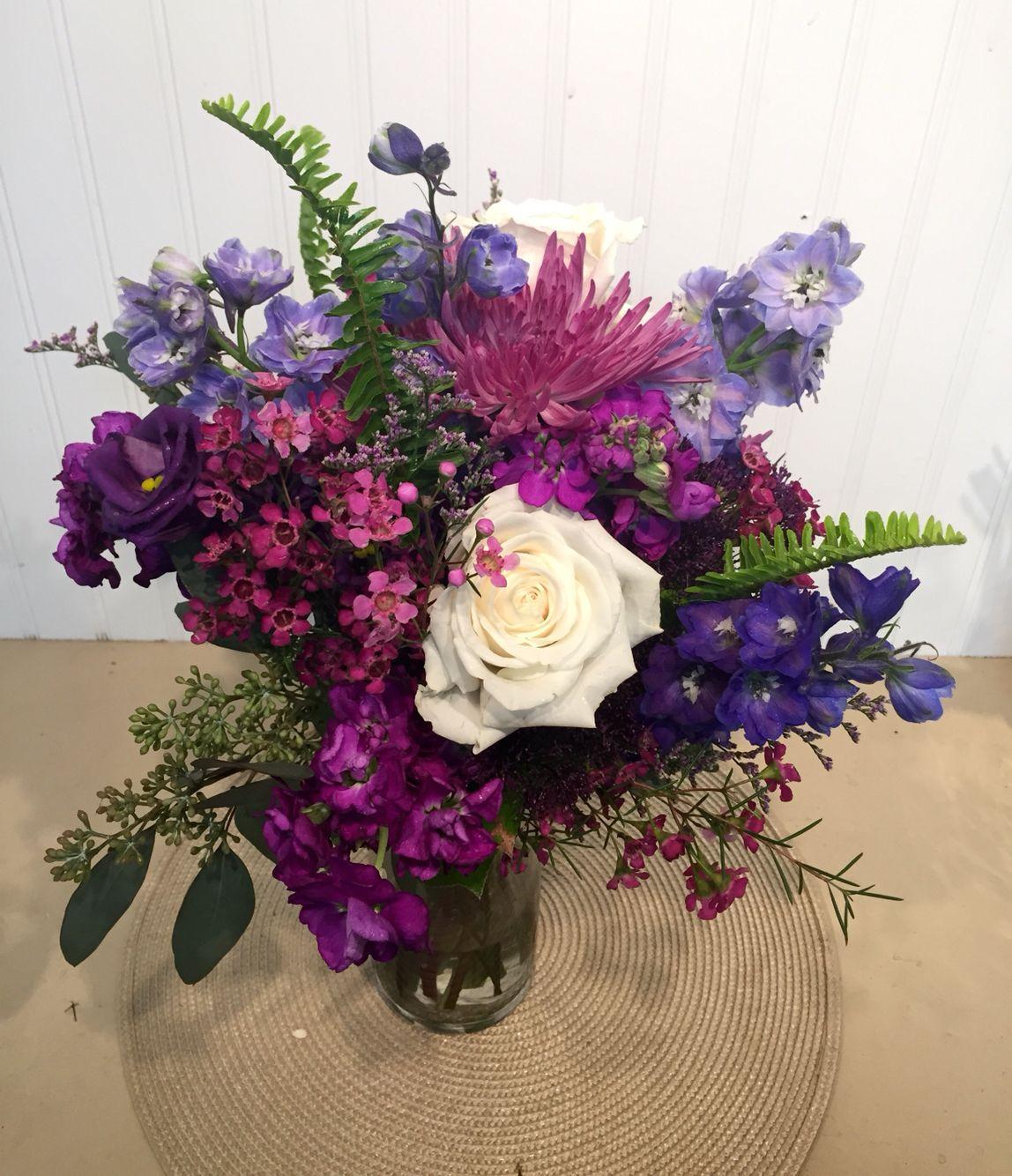A Breathtaking Purple Bridal Bouquet With Fuji Mums Roses Delphinium Stock Lisianthus Wax Flower Caspia Purple Bridal Bouquet Wedding Flowers Mum Bouquet