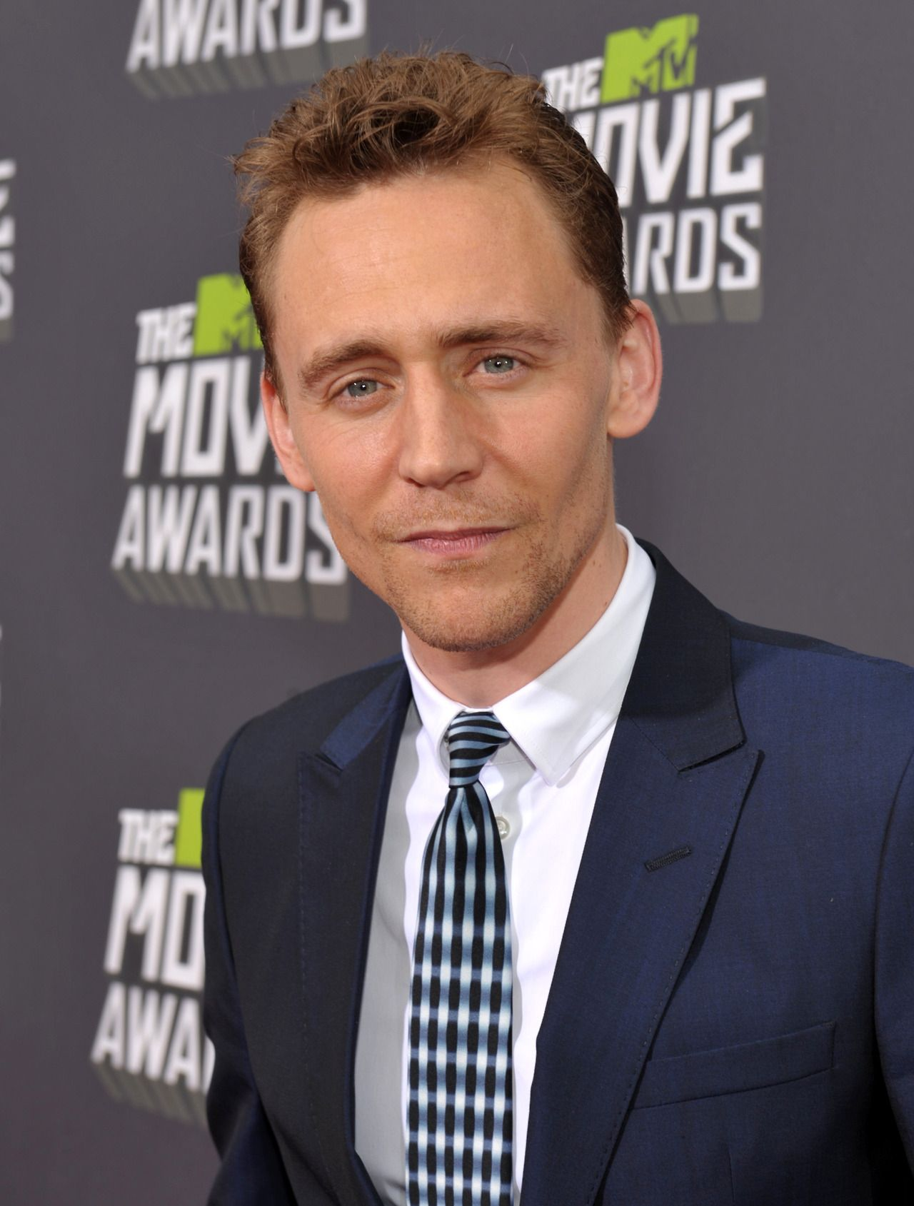 Tom Hiddleston arrives at the 2013 MTV Movie Awards at Sony Pictures Studios on April 14, 2013 in Culver City, California [HQ]