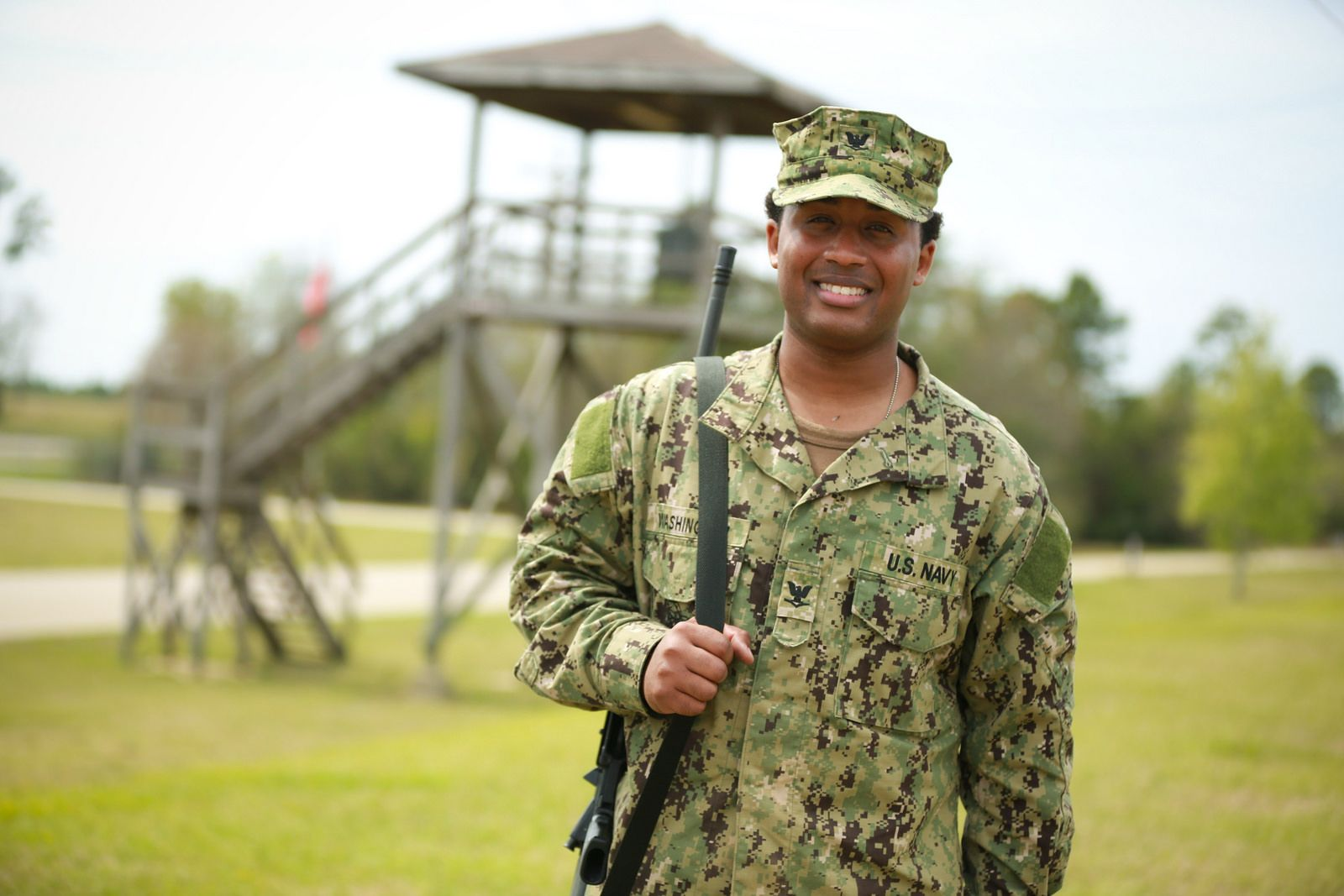 Petty Officer 3rd Class Bernard Washington, a yeoman and 2007 Westlake High School graduate from Waldorf, Md., is serving in the U.S. Navy as part of Naval Mobile Construction Battalion 74 specializing in advance base construction, battle damage repair, contingency engineering, humanitarian assistance and disaster recovery support to fleet and unified commanders. (U.S. Navy photo by Senior Chief Mass Communication Specialist Gary Ward/ Released)