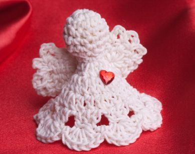 Larry's Granny made these for everyone. They have a special memory for me!     This free crochet pattern makes into a lovely angel bell ornament for your Christmas tree.  Find this and many other free crochet patterns at Craftown.
