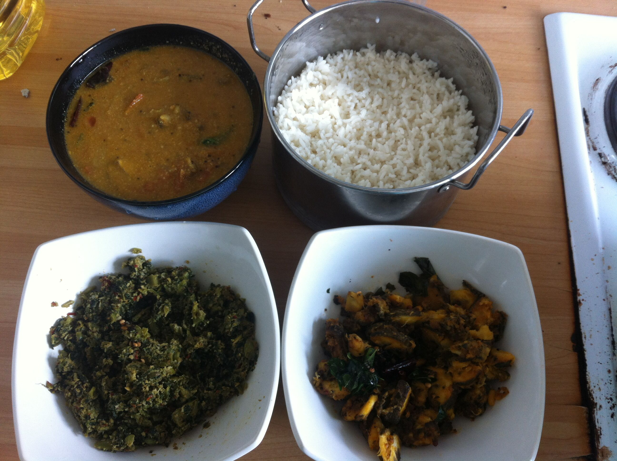 Tamil (South Indian ) lunch -rice , spinach thoran (side) , green plantain fry , elephant yam -brinjal kulambu (curry)