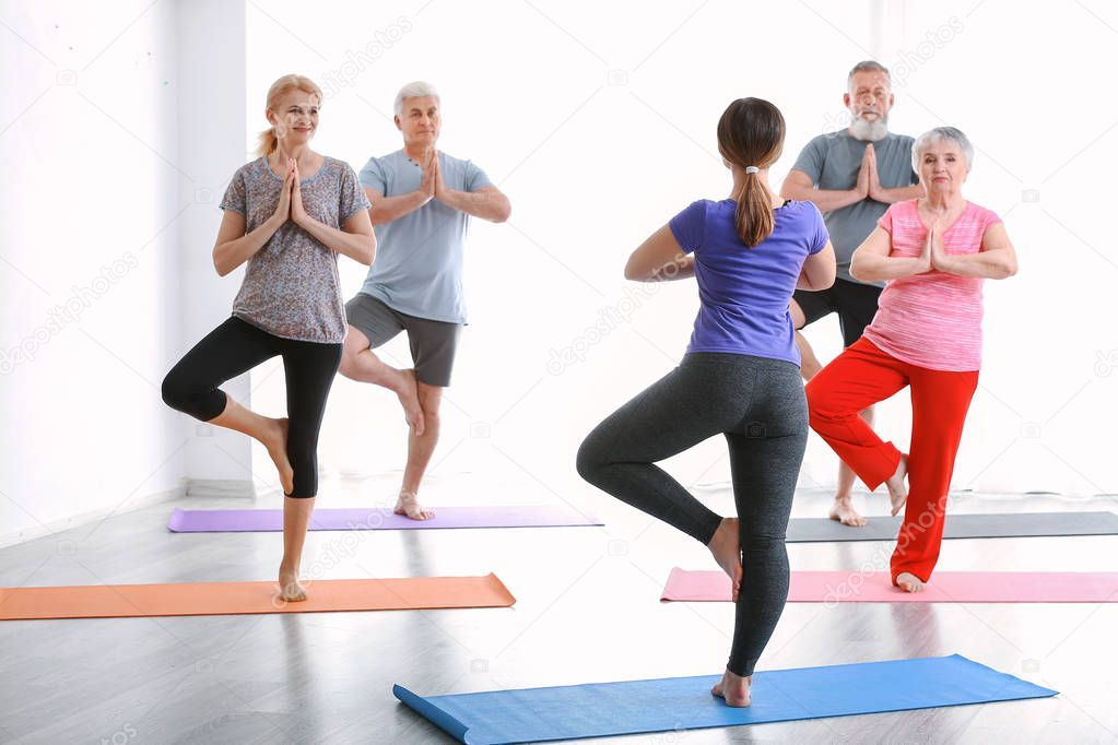 Senior People With Young Trainer Doing Exercises In Nursing Home Stock Affiliate Young Trainer Senior People Ad Do Exercise Exercise Young