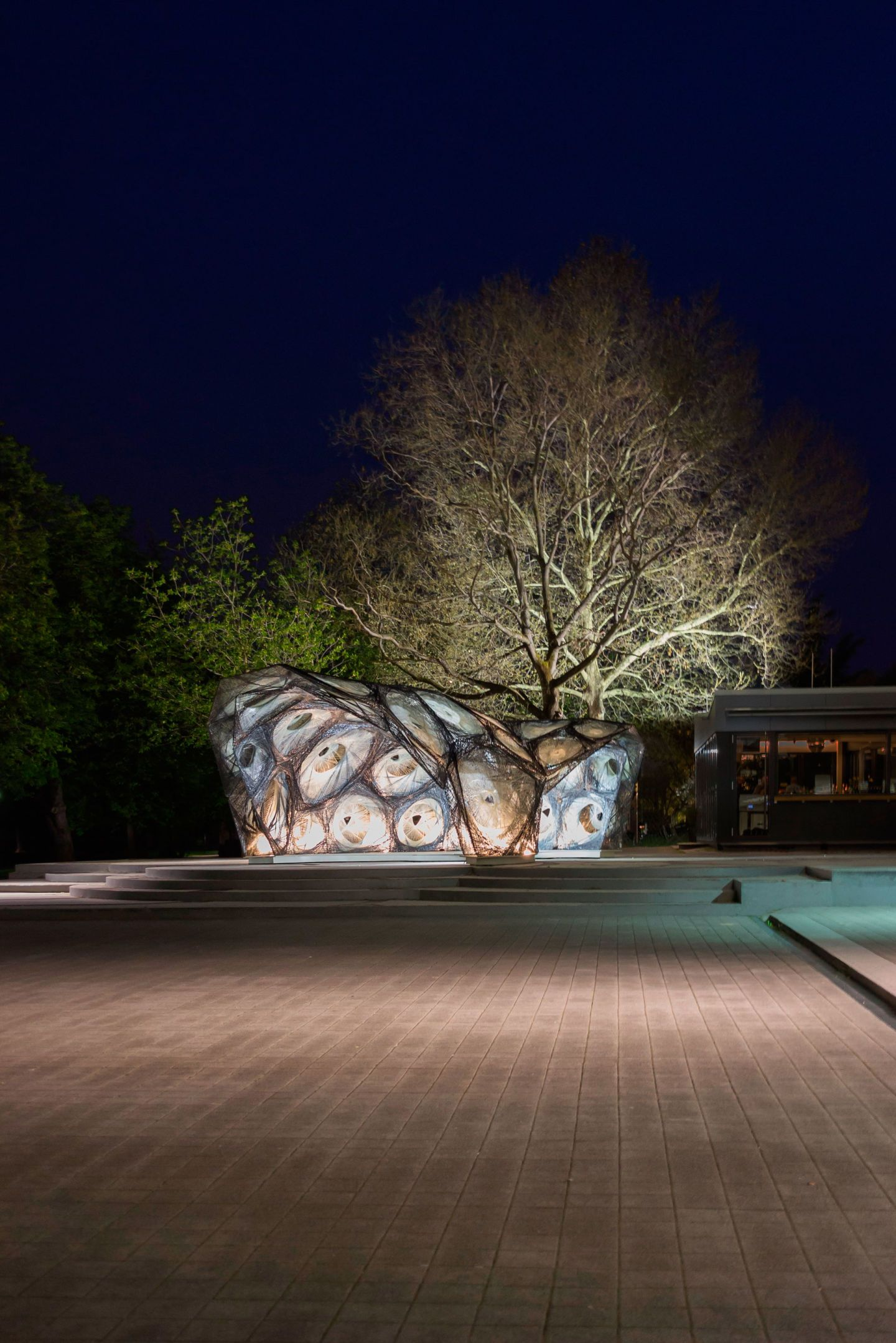 The ICD/ITKE Research Pavilion 2014-15 demonstrates the architectural potential of a novel building method inspired by the underwater nest construction of the water spider. Through a novel robotic fabrication process an initially flexible pneumatic for...