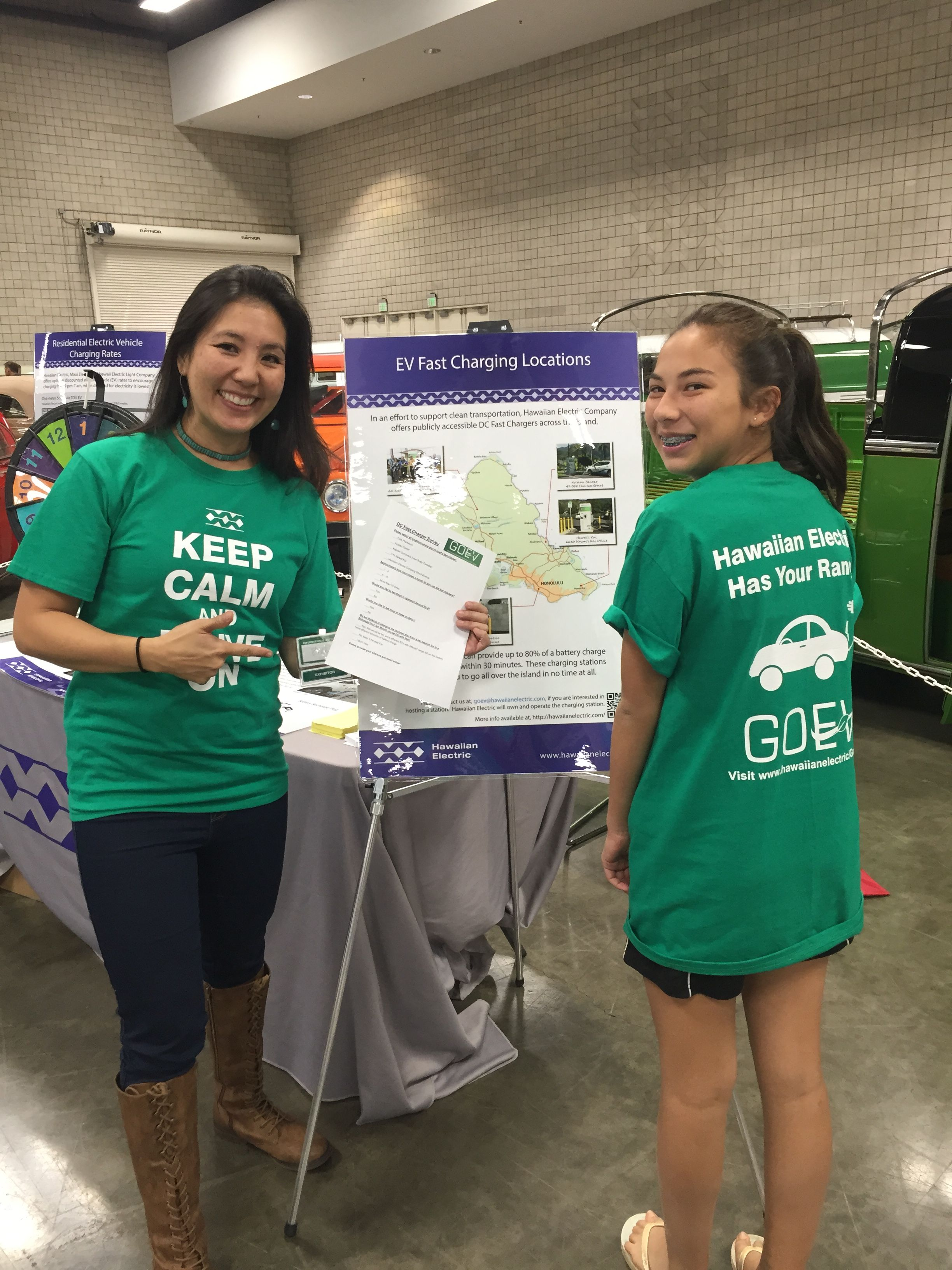 Our Hawaiian Electric team showing off their EV shirts at the First Hawaiian International Auto Show. For free online resources on electric vehicles, charging stations, and everything else EV, please visit our website: https://www.hawaiianelectric.com/clean-energy-hawaii/electric-vehicles. #EV #ElectricVehicles #GoEV