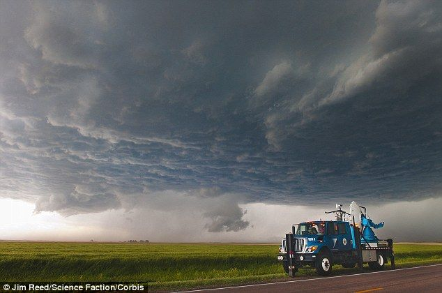 A colossal supercell thunderstorm cloud over Montana and other