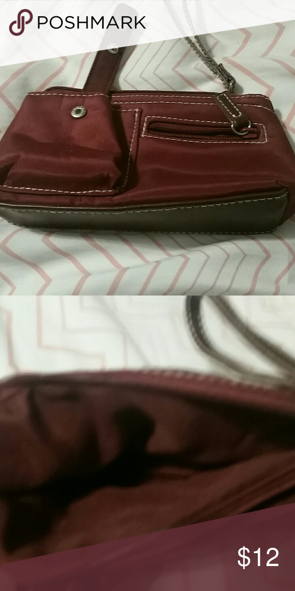 Wristlet Excellent condition. Never used. Has a large pocket with strap and a small pocket with a zipper on the outside. Maroon red. Bags Clutches & Wristlets
