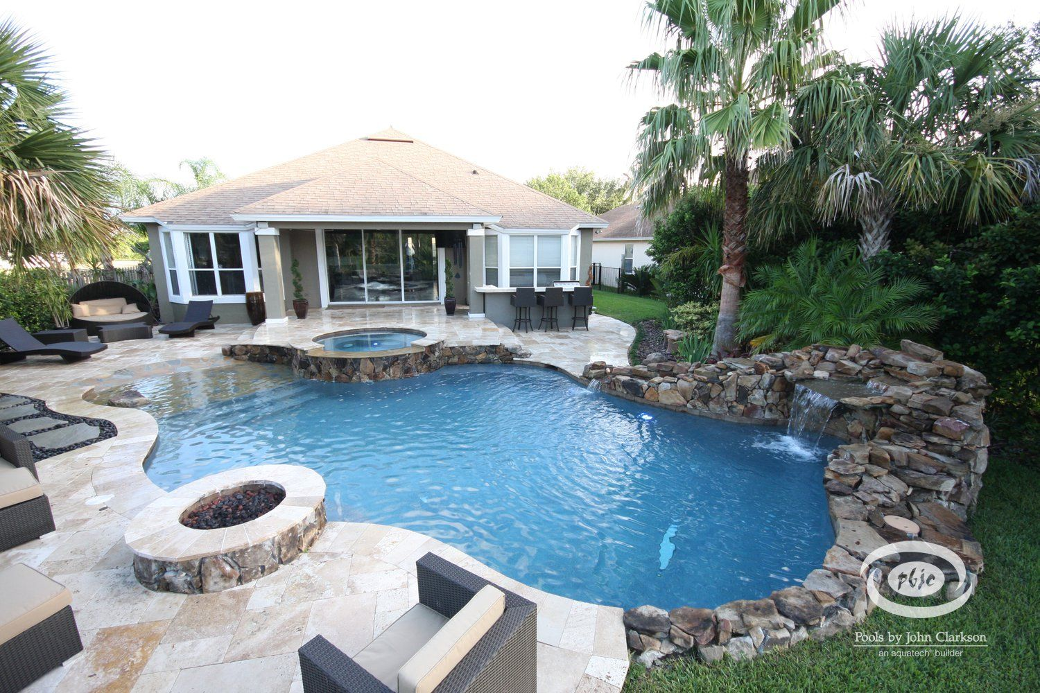 Free form pool spa w travertine pavers flagstone beach Flagstone pavers around pool
