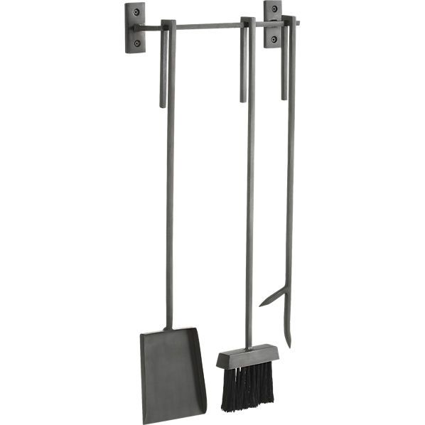"3-piece bend wall mounted fireplace tool set. 13""Wx3.5""Dx28.25""H Handcrafted Iron with raw industrial finish Nylon bristles on broom Includes wall mounted bar"