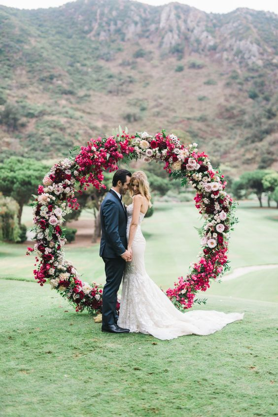 A bold fuchsia blush and hot pink floral circle wedding arch with a bold fuchsia blush and hot pink floral circle wedding arch with leaves junglespirit Choice Image
