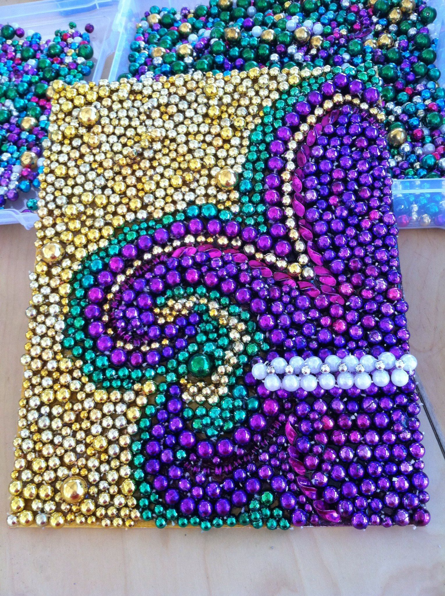 Beads glued to a canvas in a fleur de lis would be cute to do in something i will do after finally visiting new orleans for all the mardi gras beads i savedrdi gras bead fleur de lis glued on canvas board amipublicfo Images