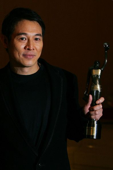 "Holding the Best Actor award for the movie ""The Warlords"" at the Hong Kong Film Awards"