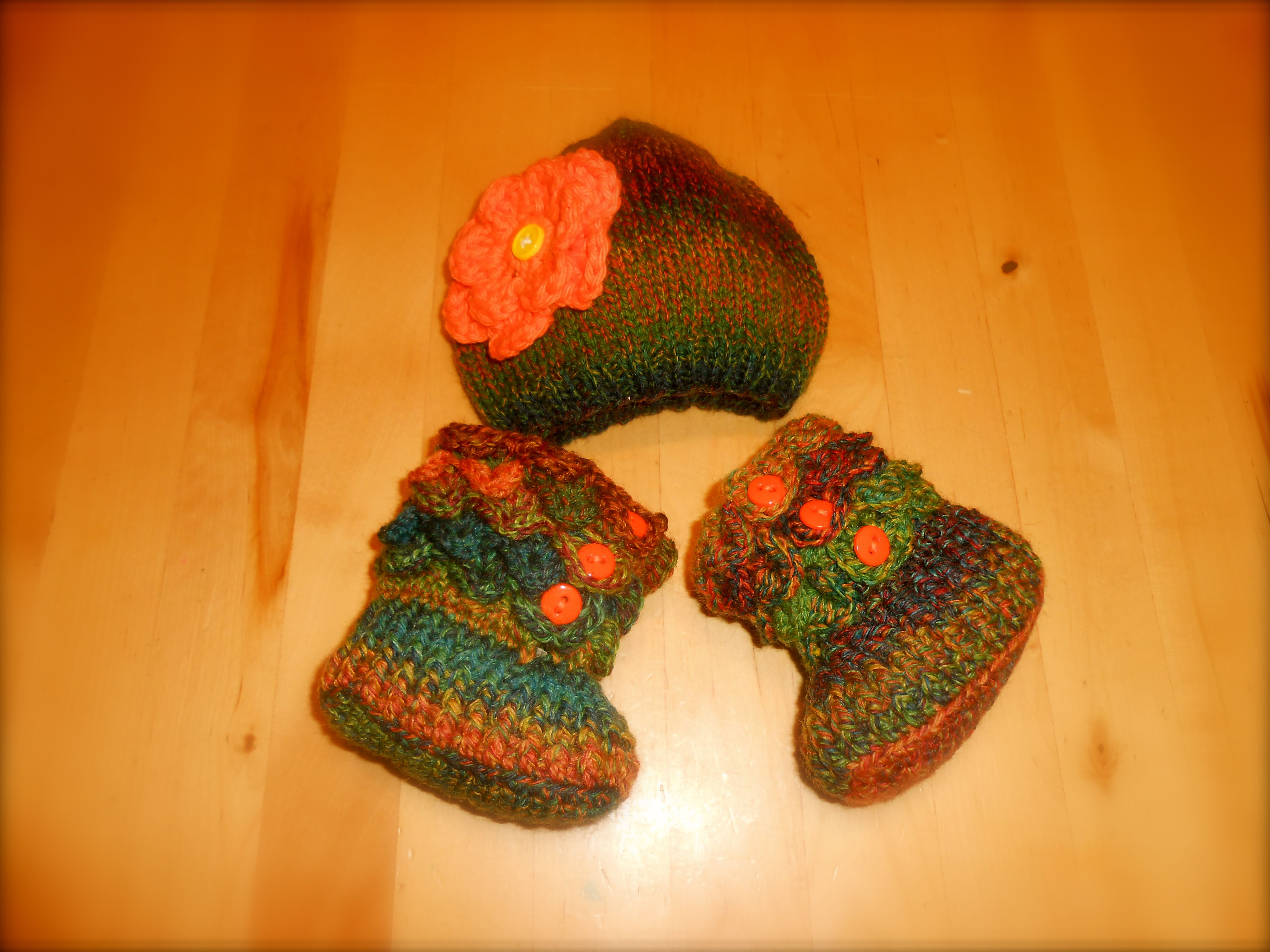 Baby girl hat and boots set. Made with an acrylic blend yarn. Boots are made in a crocodile pattern with the hat to match. visit me at www.monidesignsinc.com
