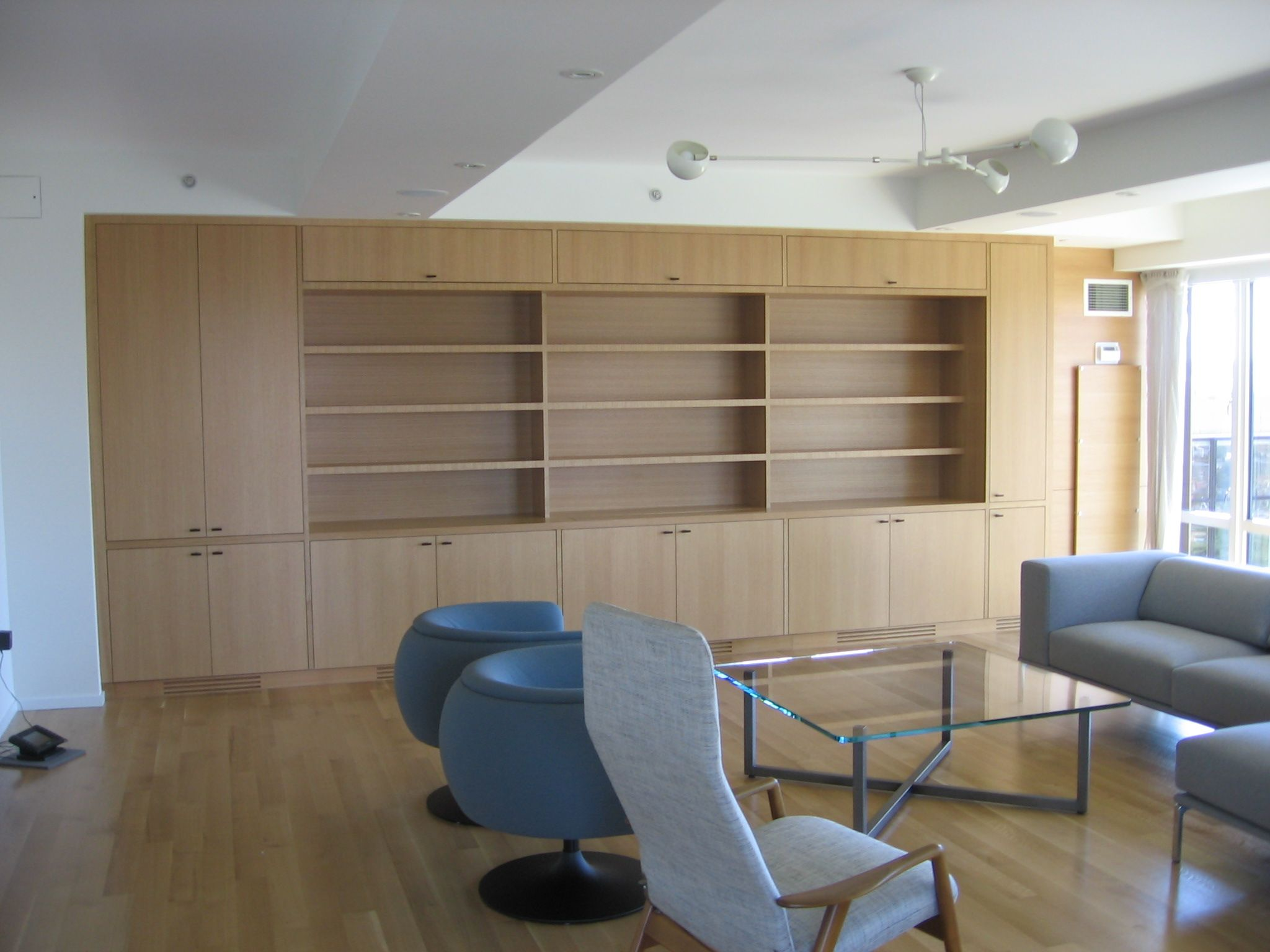 Custom Built In Wall Unit With Bookcases Fabricated In Quartered White Oak.