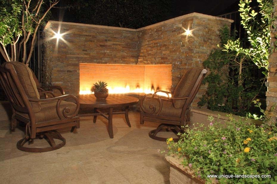 Innovative corner gas fireplace vogue phoenix traditional for Outdoor patio fireplace ideas