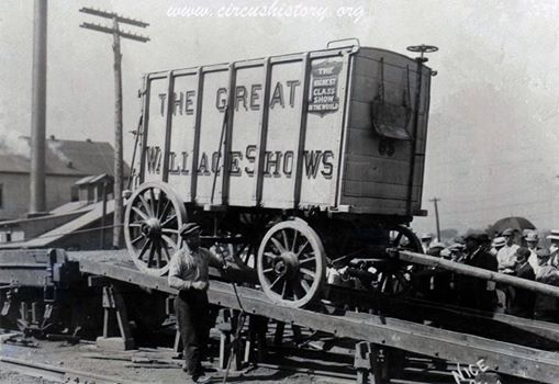 The Great Wallace Shows is arriving in small town, America. The negative is part of the Conover Photographic collection. The Photographer, date or location are not recorded.