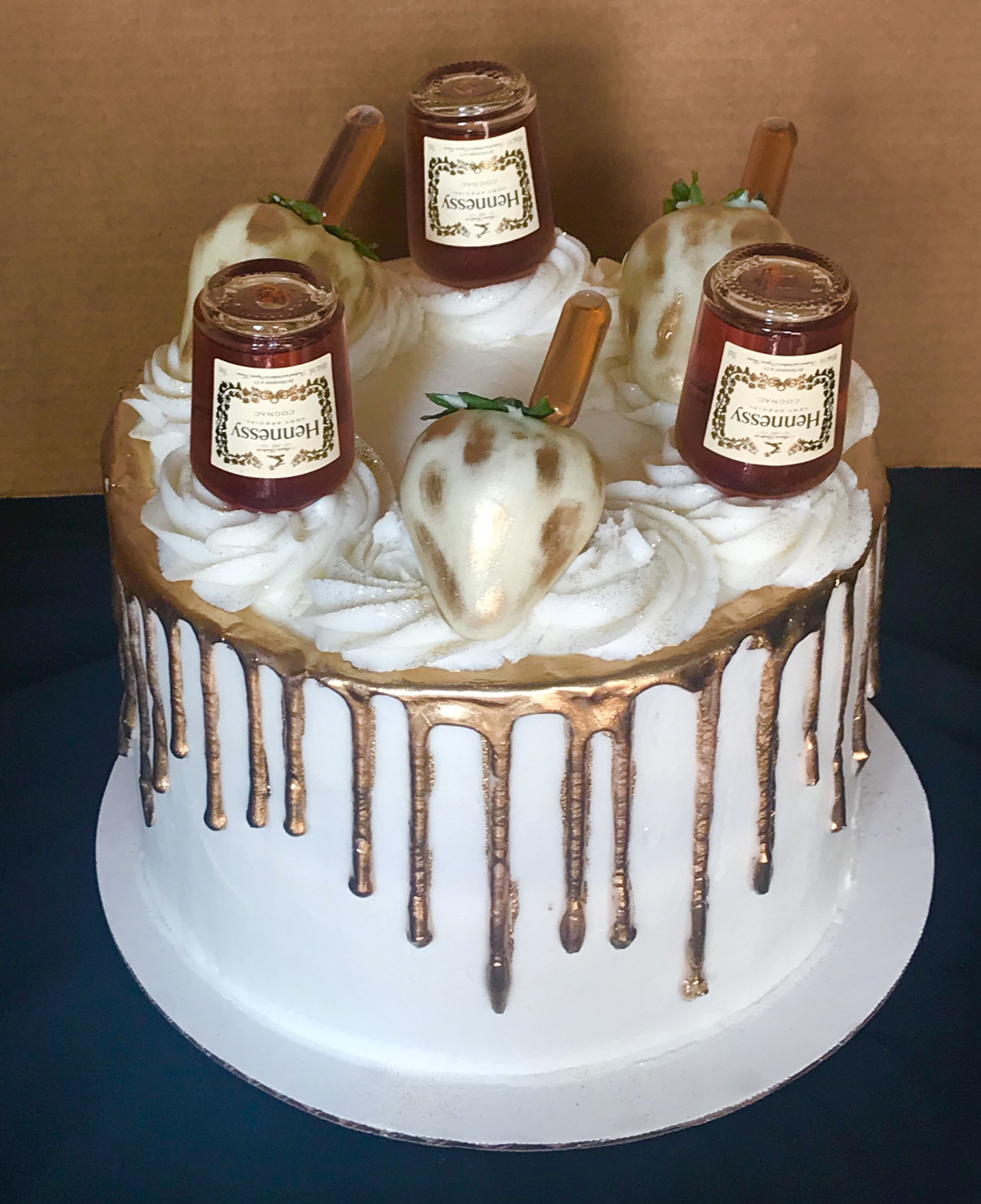 Hennessy infused into cake buttercream and strawberries