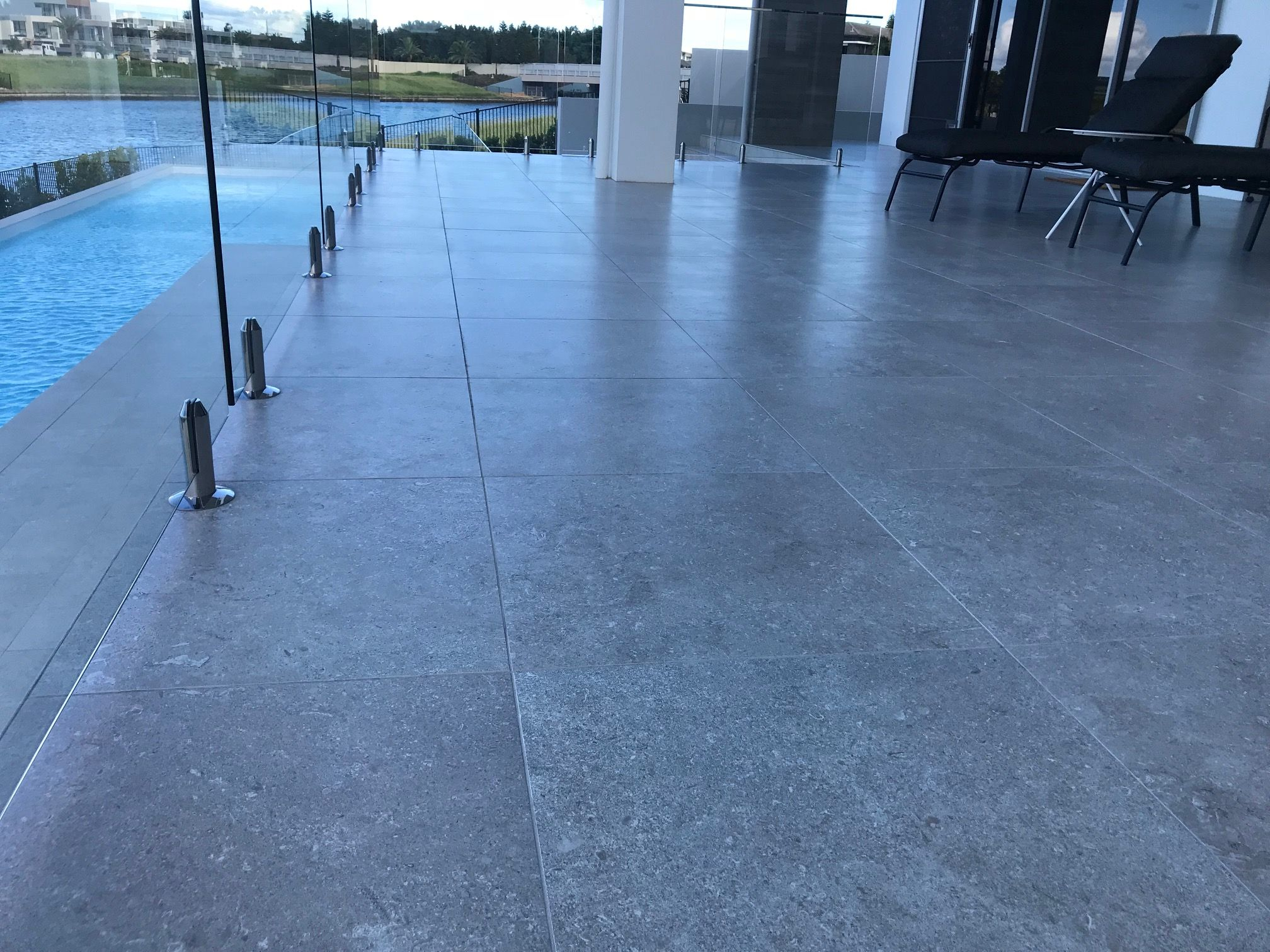 Concrete Look 450x900 Porcelain Tiles With Anti Slip Surface For This Luxury Water Front Poolside And Outdoor Modern Outdoor Industrial House Outdoor Flooring