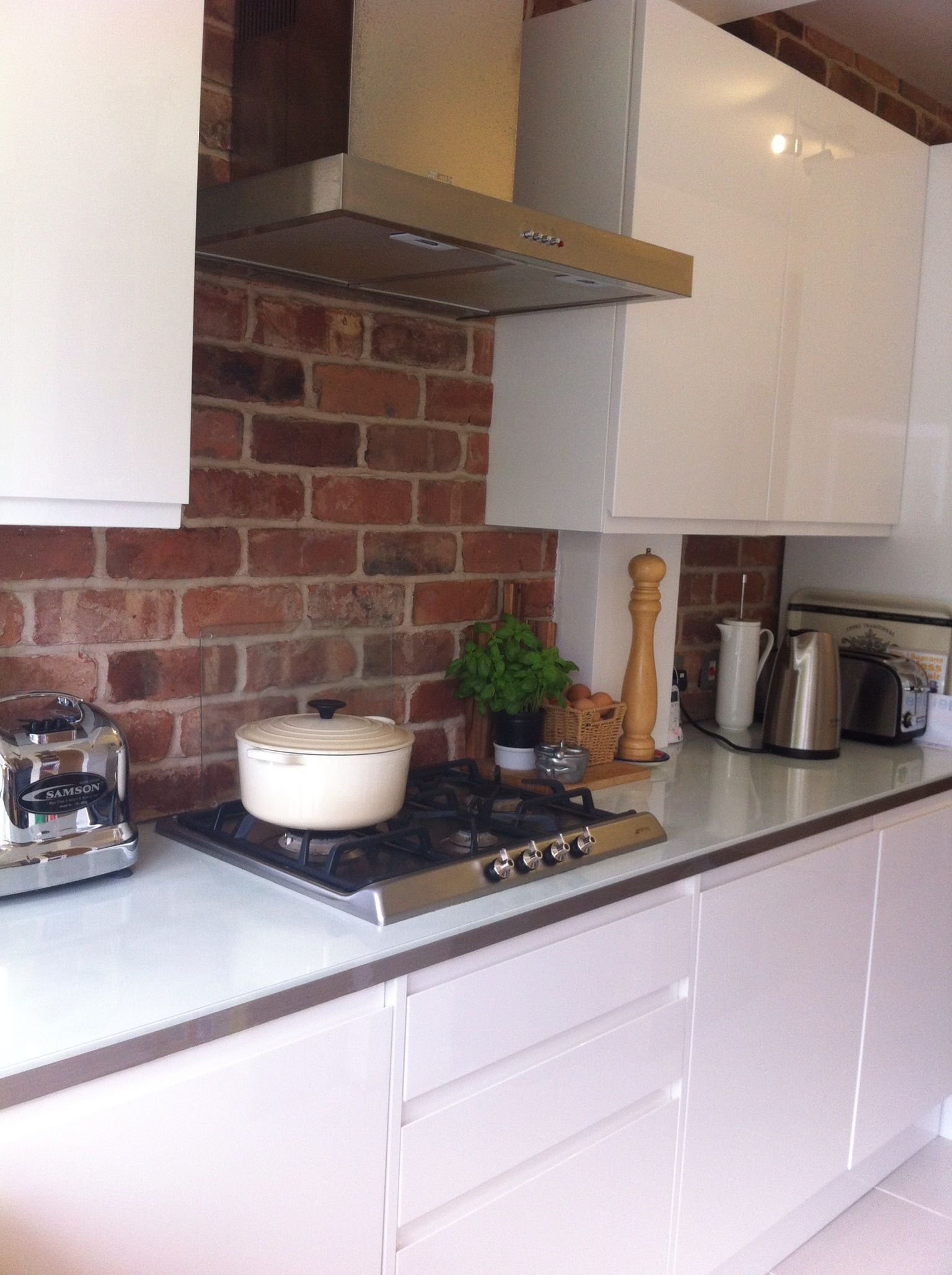 Exposed Brick Kitchen With Clean Gloss White Units Exposed Brick