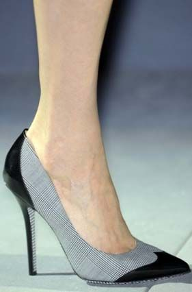 Salvatore Ferragamo.  Look at the details on the heel and sole!
