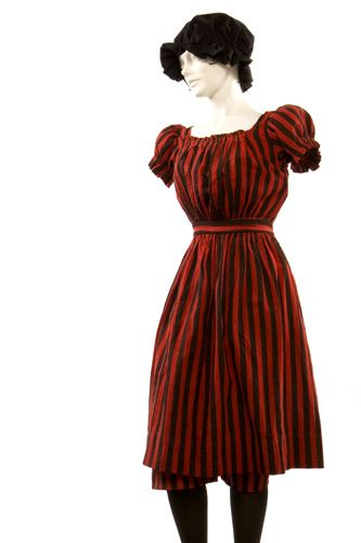 Woman's Bathing Suit, ca. 1888    Woman's Two-Piece Red and Black Vertically Striped Flannel Bathing Suit ca. 1888. Photograph by Cary Horton, 2004. Missouri History Museum, Museum Collections. Acc.# 1956 126 0001. Photograph © 2004, Missouri History Museum.    Woman's bathing suit consisting of red and black vertically striped flannel dress and bloomers. Shown with bandana.