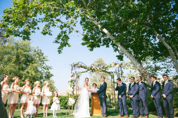 A beautiful Donna Morgan wedding featured on @Style Me Pretty with bridesmaids wearing the Donna in Candlelight