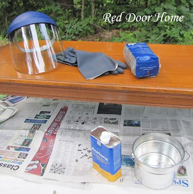 acetone will remove all inorganic elements (stain and varnish) from
