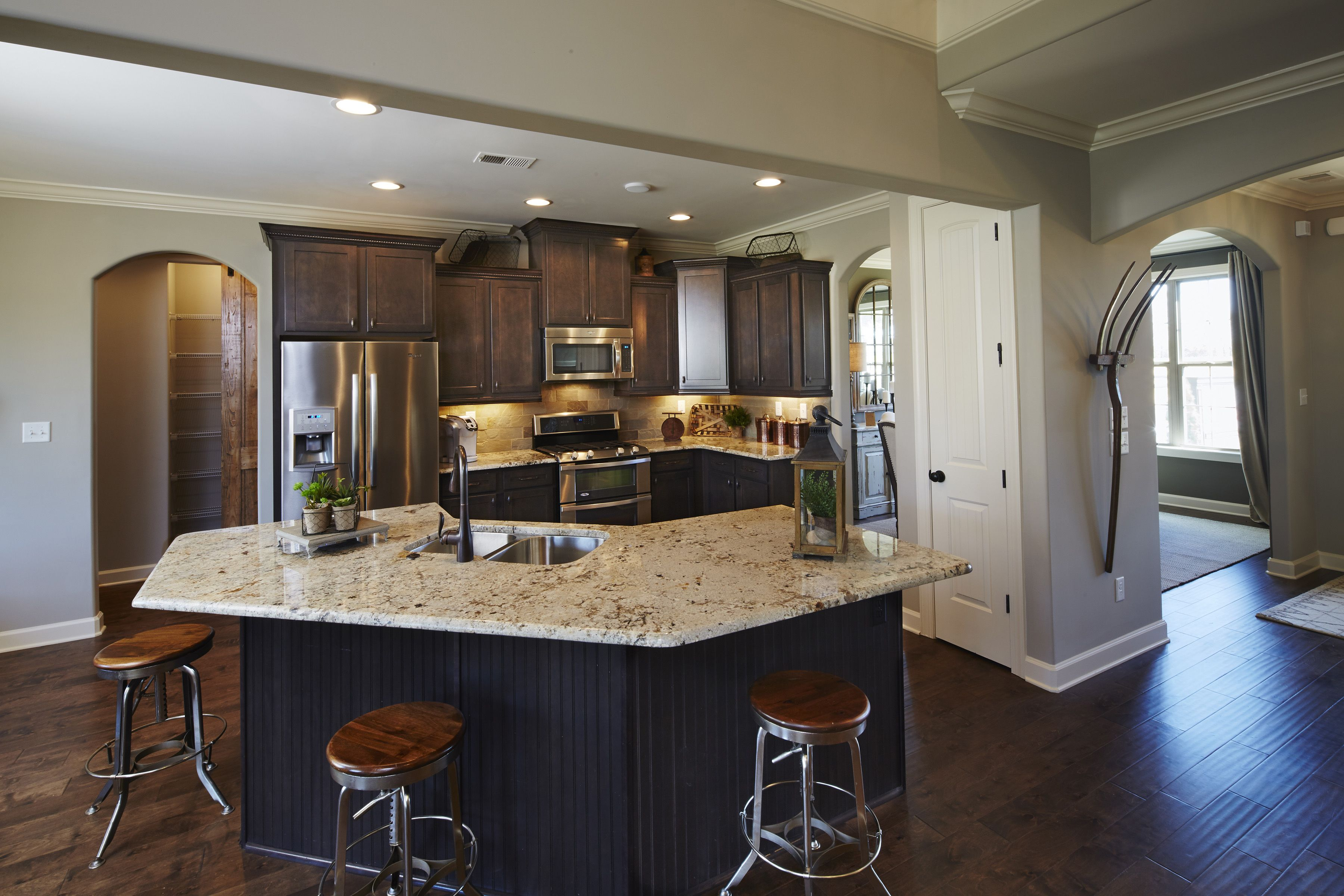 Regency Homebuilders Open Concept Living Large Kitchen Dark Cabinets Staggered Cabinets Farm Sink Flus Building A House Regency House Staggered Cabinets