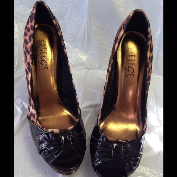 Rouge Leopard print Heels Really nice pair of gently worn Rouge heels. Satiny leopard print fabric upper and black patent leather across toe area. Size 10. There is a small spot on one of the heels, see photo 4 Rouge Shoes Heels