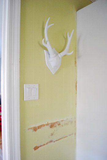 These antlers, originally black, were primed and spray painted white-- adding quirky cuteness to a grellow wall!