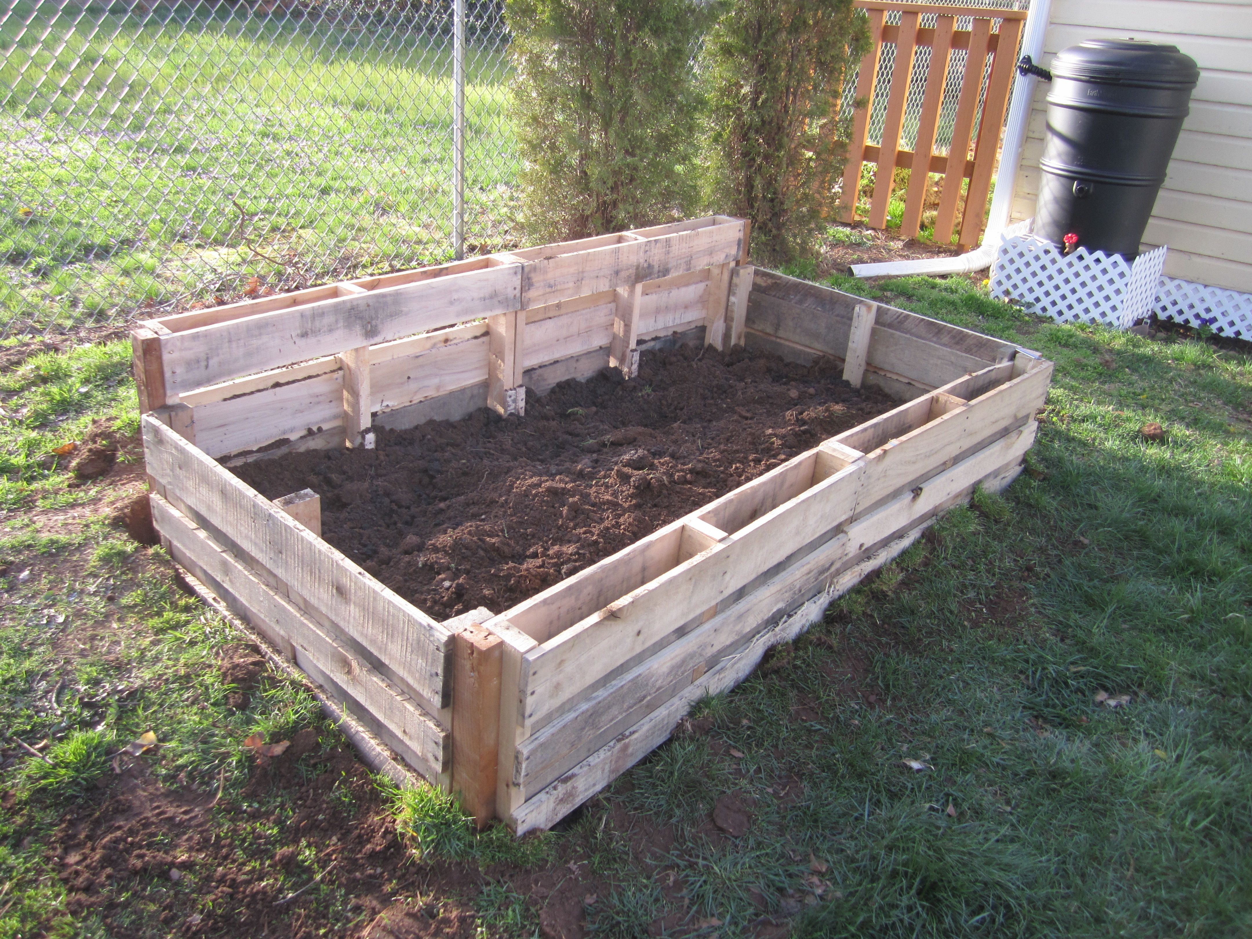 Pallet garden boxes pallet garden box garden boxes and for Pond made from pallets