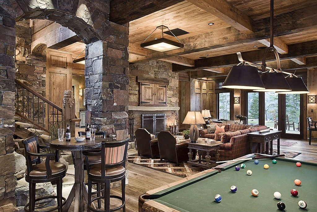 Rustic Man Cave Ideas : Gorgeous rustic basement with stone fireplace and wood ceiling
