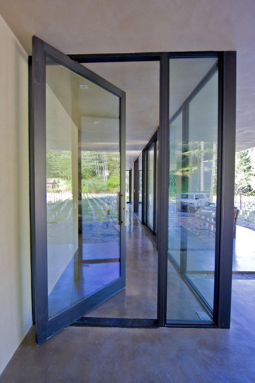 fleetwood pivot door   but reeded glass for privacy   the orange accent  color for the. fleetwood pivot door   but reeded glass for privacy   the orange