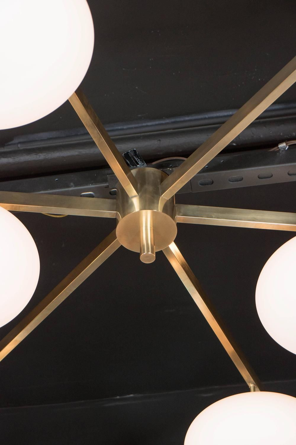 Brass and Glass Six-Arm Globe Flush Mount Chandelier in the Manner of Arredoluce   From a unique collection of antique and modern flush mount at https://www.1stdibs.com/furniture/lighting/flush-mount-ceiling-lights/
