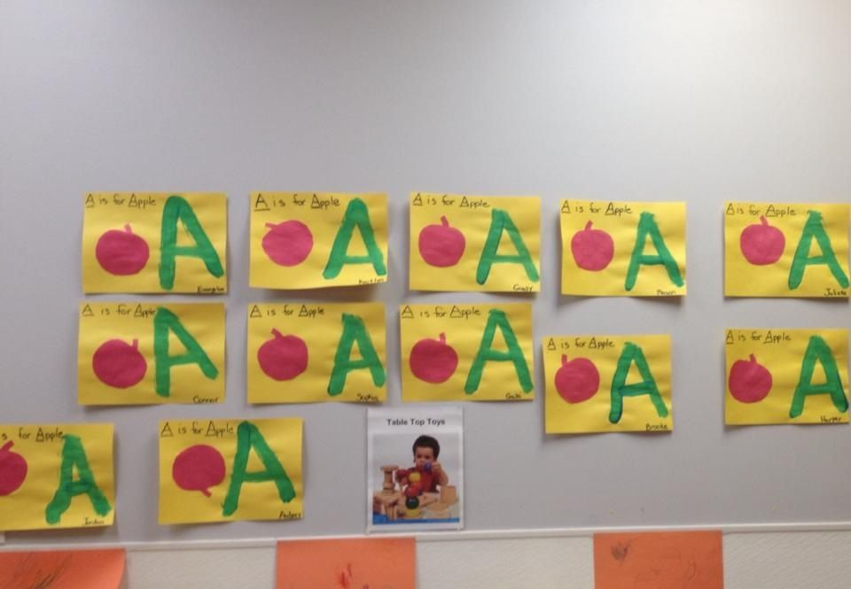 "The children painted the letter ""A"" and an apple in the Dolphins class."