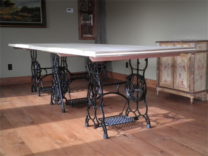 handmade table with antique sewing machine bases