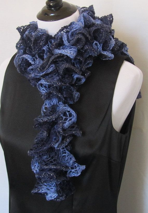 Hand knitted women's ruffle scarf in dark navy blue and light blue with a silver thread along the edge that makes it sparkle.